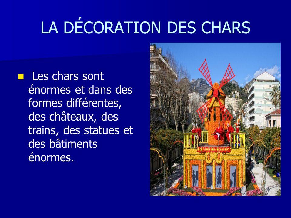 LA DÉCORATION DES CHARS Les chars sont énormes et dans des formes différentes, des châteaux, des trains, des statues et des bâtiments énormes.
