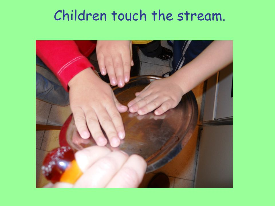 Children touch the stream.