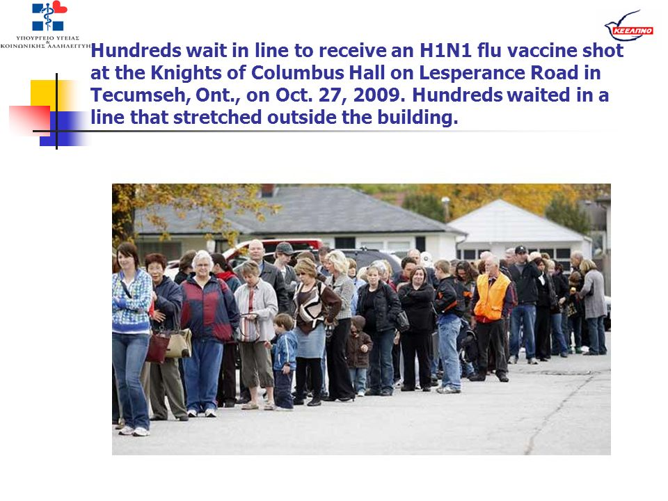 Hundreds wait in line to receive an H1N1 flu vaccine shot at the Knights of Columbus Hall on Lesperance Road in Tecumseh, Ont., on Oct. 27, 2009. Hund