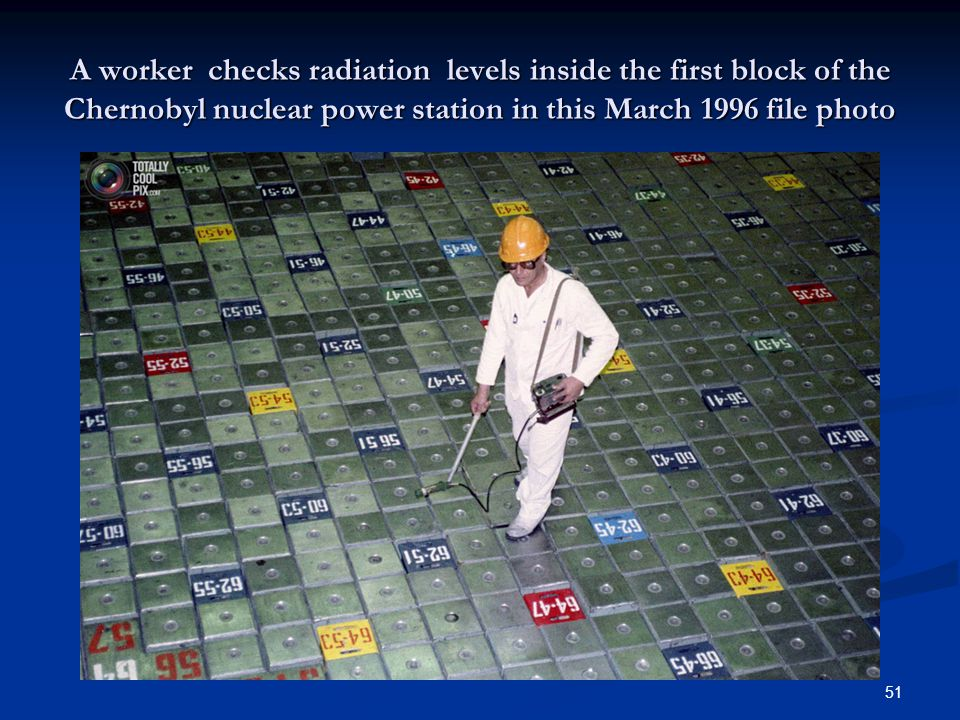 A worker checks radiation levels inside the first block of the Chernobyl nuclear power station in this March 1996 file photo 51